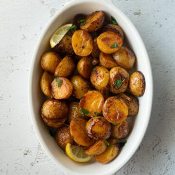 roasted potatoes in a white baking dish